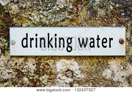 label for potable water on old wall