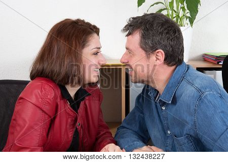 Smiling Young Businesswoman Flirting With Man In The Office