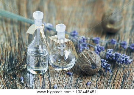essential oil with lavender flowers and nutmeg