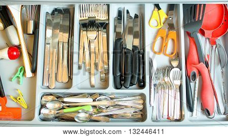 cutlery drawer texture above view background silverware colorful compartments kitchen utensils