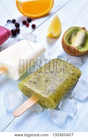 Summer cold dessert frozen popsicles from fruits shallow depth of field