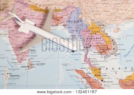 Travel Destination Thailand. Passenger Plane Miniature Over The Map