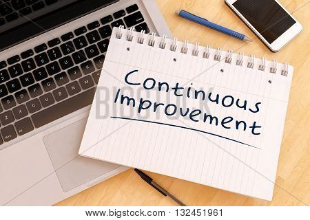 Continuous Improvement - handwritten text in a notebook on a desk - 3d render illustration.