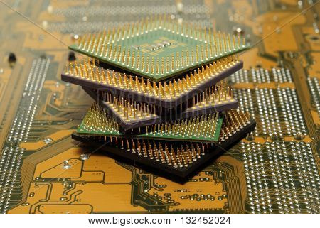 Stack of CPU processor and Circuit board / Motherboard. Electronic computer hardware technology. Motherboard digital chip. Tech science. Information engineering component.
