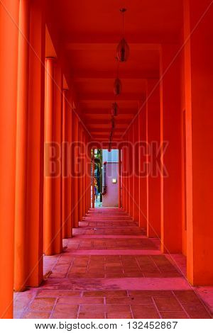 Colorful walkway thru a hallway with modern contemporary architecture and design