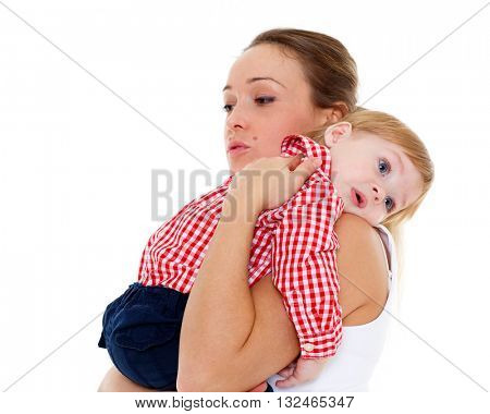 Mother with small resentful baby on a white background.