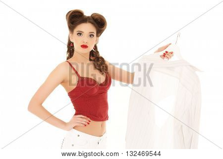 Young unhappy beautiful woman with spoilt shirt on a white background. Housewife.