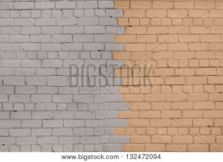 Brick Wall in Grey and Biege Colors Divided on Two Halfs on the Middle