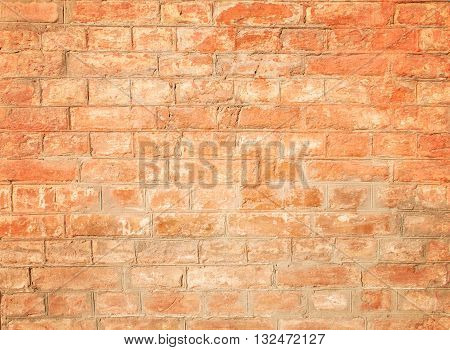 Background with Old Red Brick Wall Covered in Peels which Makes Specific Texture