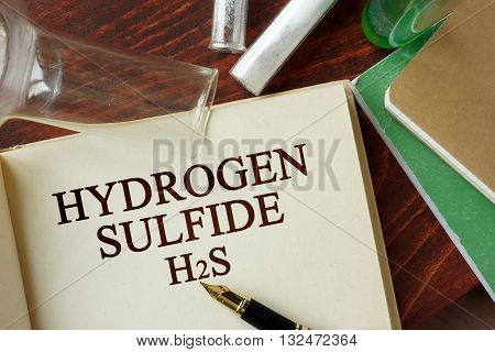 Words hydrogen sulfide written on a page. Chemistry concept.