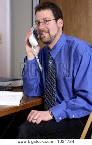 Middle-Aged Man Talking On The Phone