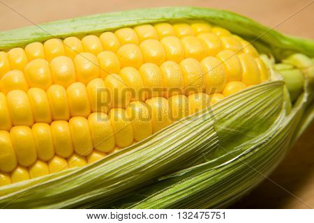 Fruit ripe corn with leaves in large