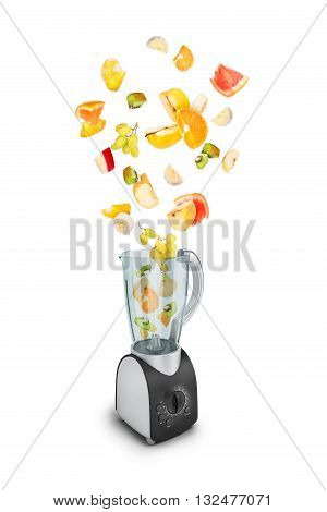 Fruit falling in a juicer on white background
