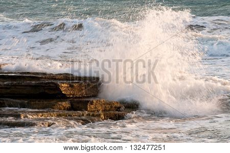 Dangerous Waves crashing with power on sea rocks.