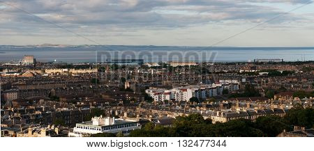 Panoramic view of the Cityscape of Edinburg city the capital of Scotland from the Calton Hill on a cloudy day