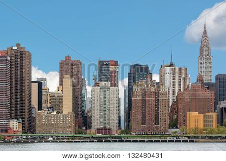 NEW YORK, USA - Apr 27, 2016: Manhattan skyline with Chrysler Building. View from Queens over the East River