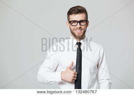 Handsome Businessman Showing Thumbs Up Sign On Gray Background.