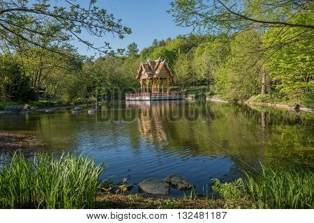 asian garden with pond and thai temple westpark munich