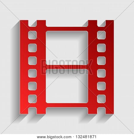 Reel of film sign. Red paper style icon with shadow on gray.