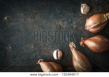 Shallots with garlic on the old metal background top view