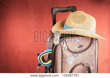 Full Suitcase of a traveler with a Hat on it