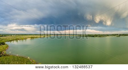 Stormy clouds over one of numerous reservoirs in near Loveland in northern Colorado - aerial panorama