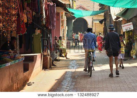 GOKARNA KARNATAKA INDIA - JANUARY 29 2016: Crowded narrow strett with outdoor shops in Gokarna city