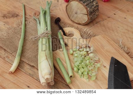 fresh lemon grass is herb on wood background