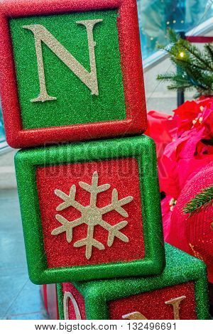 Christmas decorative boxes in vibrant red and green colors - in closeup view. Usually found sitting underneath a Christmas tree.