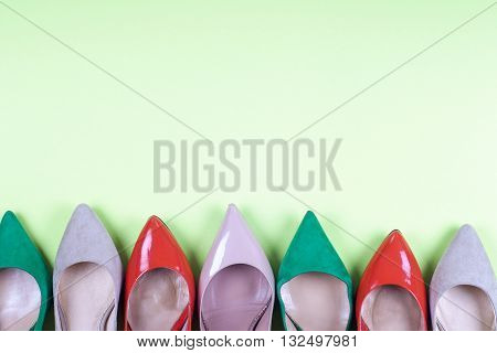 set of different shoes Shot of several types of shoes Several designs of women shoes. Leather Shoe. Pile of various female shoes on light background. Copy space for text.