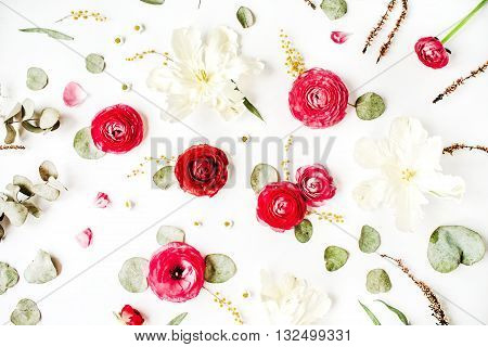 Pattern with pink and red roses or ranunculus white tulips and green leaves on white background. Flat lay top view