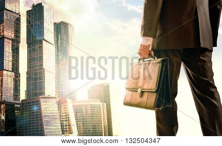 Man with suitcase looking on city, closeup