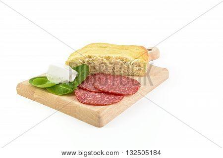 focaccia salami and gorgonzola on chopping board