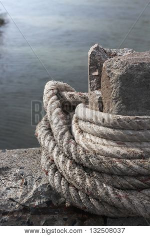 anchor rope tie up the stone pillar