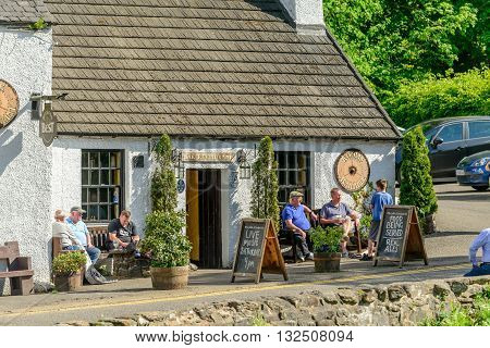 KILLIN SCOTLAND - JUNE 01 2016: Customers sitting outside of the Falls of Dochart Inn in Killin.