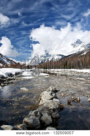 Panorama on Val Ferret, with Dora in the foreground and in the background the Mont Blanc and Val Veny