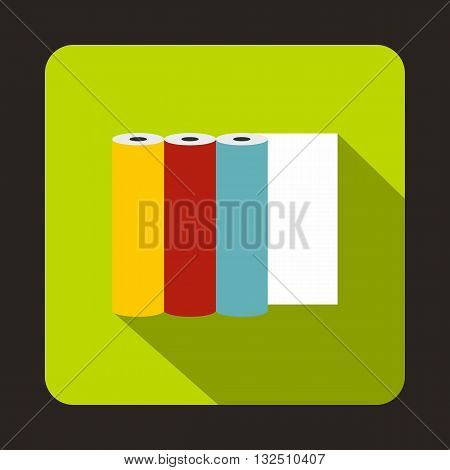 Rolls of colored paper icon in flat style on a green background