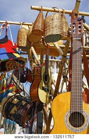 Acoustic Guitars drums and basketry in a fair shop