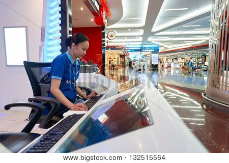 DUBAI, UAE - MARCH 09, 2016: Dubai International Airport staff. Dubai International Airport is the primary airport serving Dubai, United Arab Emirates
