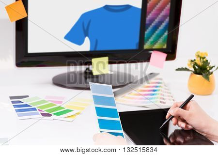 Graphic designer at work. Color swatch samples.
