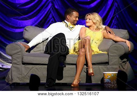 NEW YORK-JAN 12: Witney Carson (R) and Alfonso Ribeiro perform at Dancing with the Stars: Live! Tour at the Beacon Theatre on January 15, 2015 in New York City.