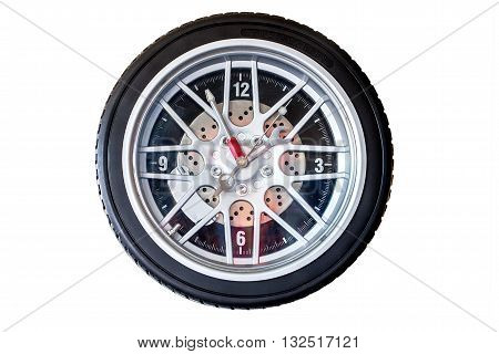 Isolated tire wall clock with analog time keeping.