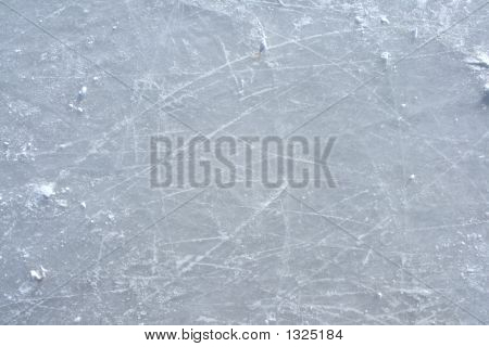 Skate Marks On The Surface Of An Outdoor Ice Rink