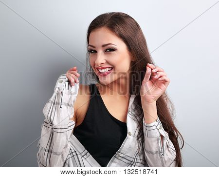 Happy Casual Toothy Laughing Woman Looking Happy On Blue Background