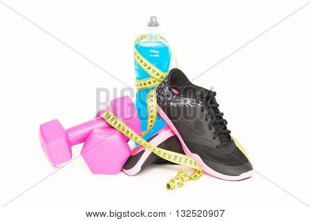 Pair of sport shoes and fitness accessories. White background.