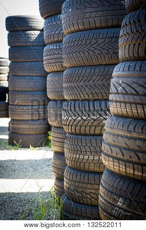 Stack of new tires for sale at a tire store.