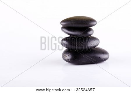 Few Black Lava Stones Stacked At Each Other