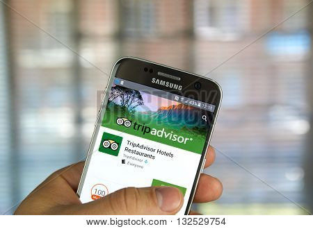 MONTREAL CANADA - MAY 23 2016 : TripAdvisor application on Samsung s7 phone screen. TripAdvisor Inc. is an American travel website company providing reviews of travel-related content.
