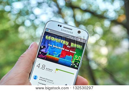 MONTREAL CANADA - MAY 23 2016 : Geometry Dash game on Samsung S7 screen. Geometry Dash is a 2013 mobile game and Steam game developed by Sweden-based developer Robert Topala