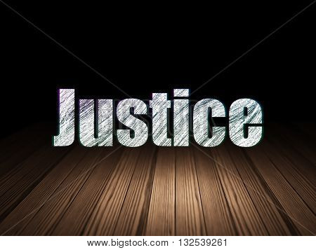 Law concept: Glowing text Justice in grunge dark room with Wooden Floor, black background
